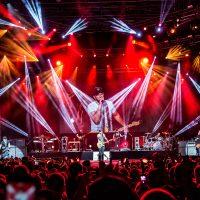 Luke Bryan performing on main stage at Crash My Playa