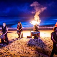 Drummers with fire on beach at Crash My Playa
