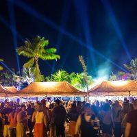 Vendor booths and crowd at Crash My Playa