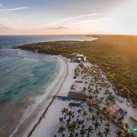 Bird's eye view of Caribbean beach for Crash My Playa