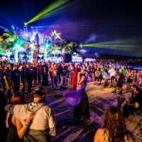 Dancer performing at Crash My Playa in crowd of attendees