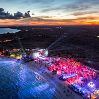 Bird's eye view of Crash My Playa concert vacation at sunset on Caribbean Sea