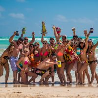 Group of festival attendees on the beach at Crash My Playa